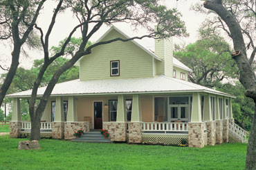 Hill country retreat for Hill country house plans with wrap around porch